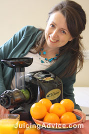 Cindy juicing with her juicer