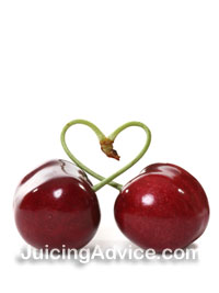 two cherries froming a heart shape