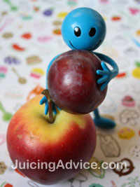 Blue toy man holding a plum