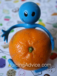 Kids toy holding an orange ready for juicing