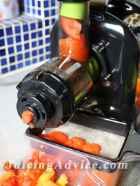 Juicing tomatoes as part of a juicing recipe.