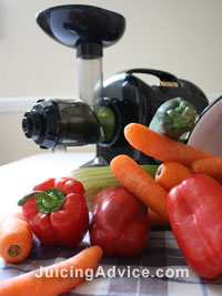 Juicing fresh vegetables with a juicer
