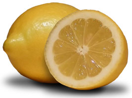lemon being used for a juicing for detox recipe