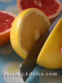 Slicing grapefruit to make a citrus blast juice.