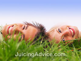 Couple lying in a feild of wheatgrass