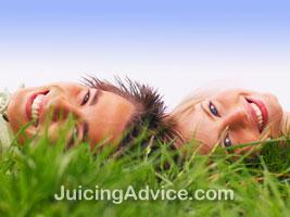 Couple lying in a feild of wheatgrass